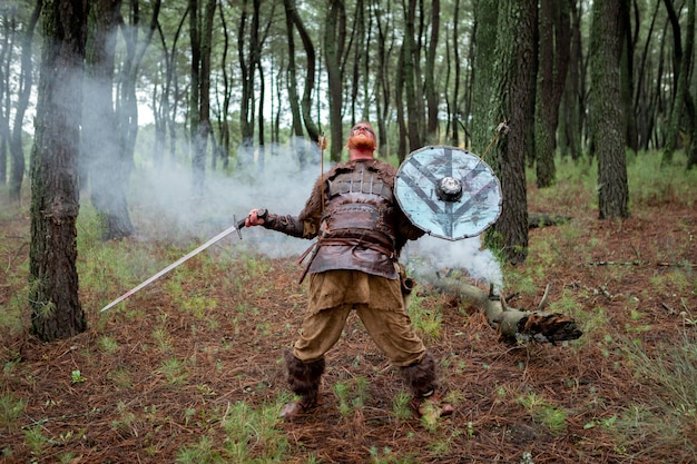 Bloody real viking with his sword training for combat