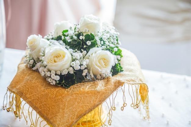 Blooming fresh rose flower bouquet on reception desk background