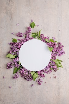 Blossom syringa vulgaris in lilac flower and blank paper card for text messagetop view