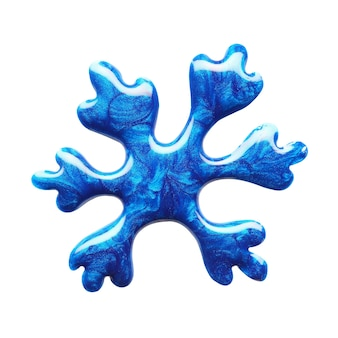 Blot of blue nail polish shaped snowflake isolated on white background. macro photo. top view