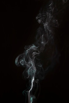 Blowing white smoke overlay on black background
