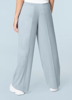 Синие свободные брюки трапециевидной формы женская одежда вид сзади