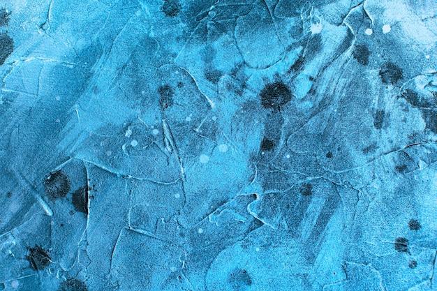 Синий абстрактный фон текстура с пятнами штукатурки и брызгами