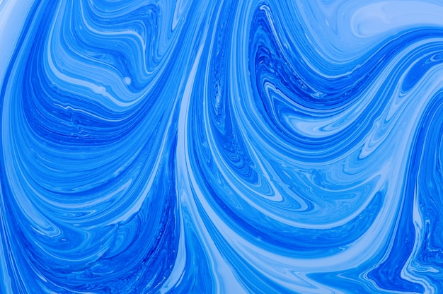 Blue abstract background. white and blue acrylic paints. marble liquid acrylic texture.