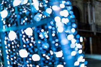ブルーの抽象的な照らされた背景のボケ味