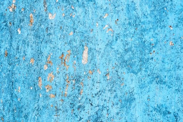 青い抽象的なメタリックな背景。錆とスクラッチ