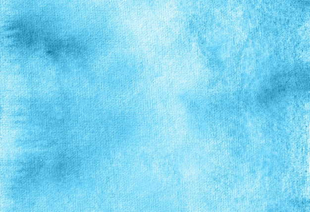 Blue abstract pastel watercolor hand painted background texture.