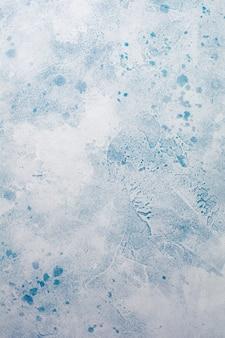 青い抽象的な雪に覆われたコンクリート テクスチャ背景またはスレートの壁。