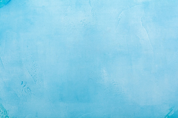 青い抽象的な雪に覆われたコンクリートのテクスチャ表面