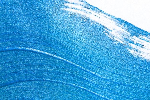 白い紙の背景に青いアクリル絵の具のテクスチャ