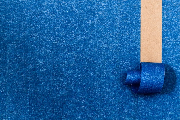 Blue adhesive background with roll-up line