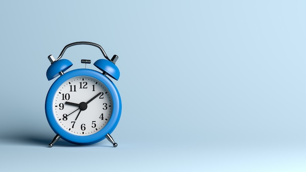 Blue alarm clock on blue