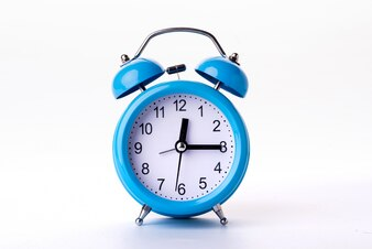 Blue alarm clock on white background