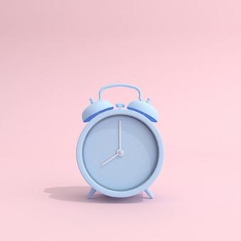 Blue alarm clock on pink background
