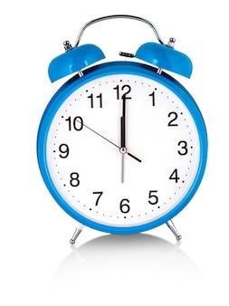 Blue alarm clock on white. a wake white dial