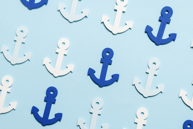 Blue anchors on a blue wall. pattern.