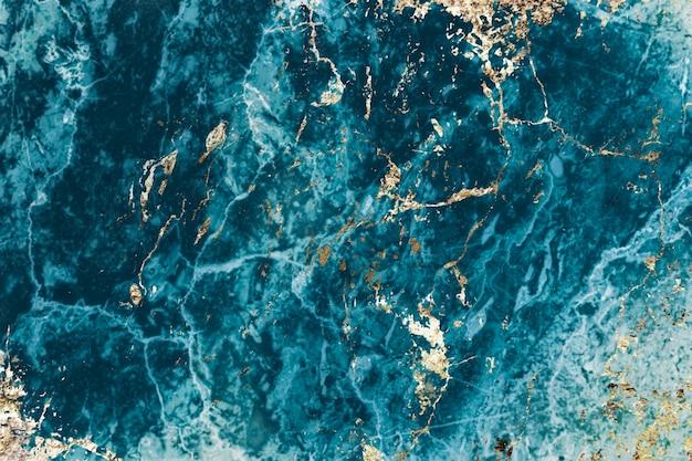青と金の大理石の織り目加工の背景