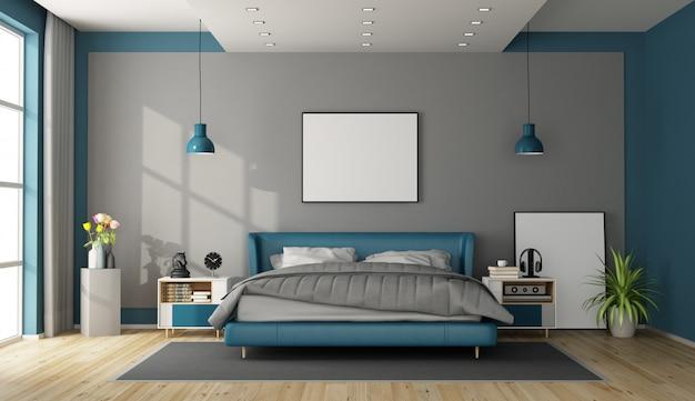 青と灰色のモダンなベッドルーム