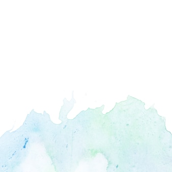 Синее и зеленое смешанное акварельное пятно на белом фоне