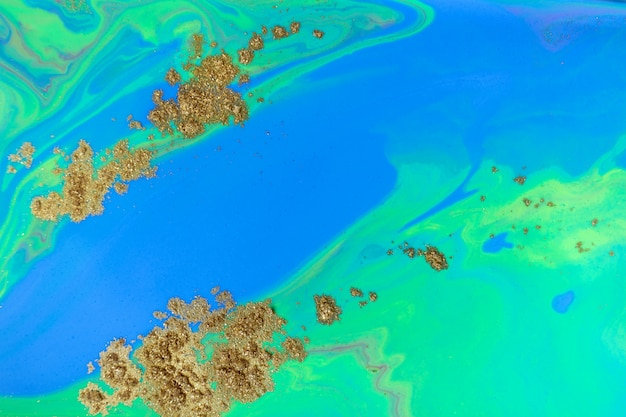 파란과 녹색 바다 추상적 인 배경입니다. 금 가루와 액체 대리석 패턴입니다.