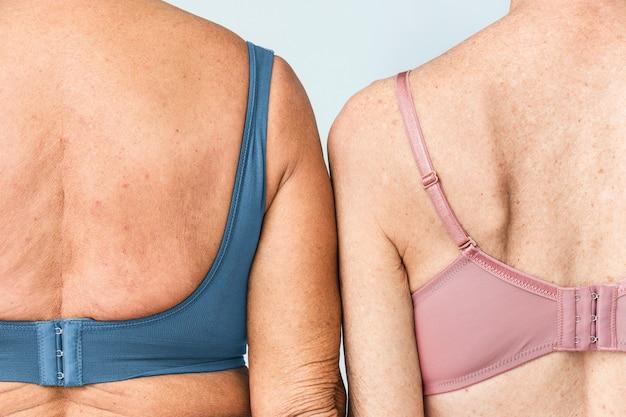 Синий и розовый бюстгальтер женское нижнее белье снимают одежду сзади, вид сзади