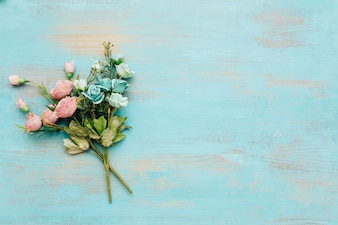 Blue and pink flowers with vintage wooden background.
