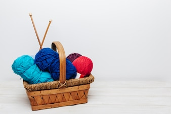 Blue and red wool balls in basket