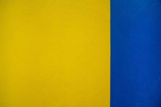 青と黄色の壁の背景のテクスチャ