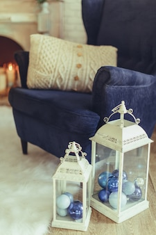 Blue arm-chair with knitted beige pillow, modern interior