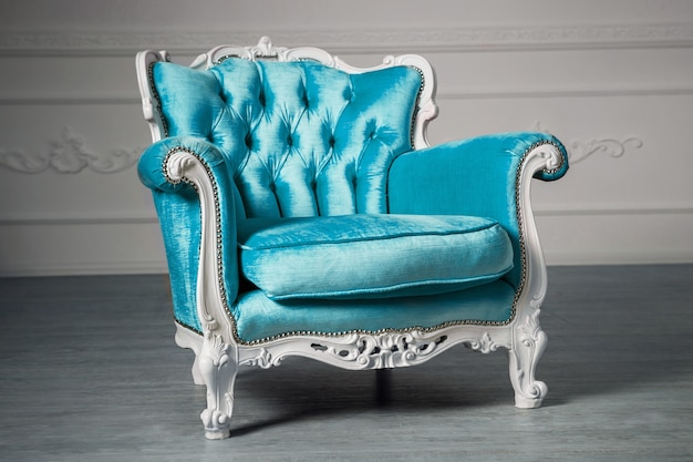 Blue armchair in the room