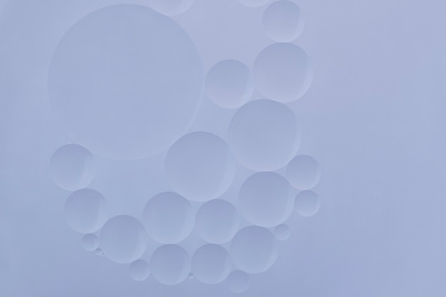 Carta da parati astratta di struttura della bolla di olio del fondo blu