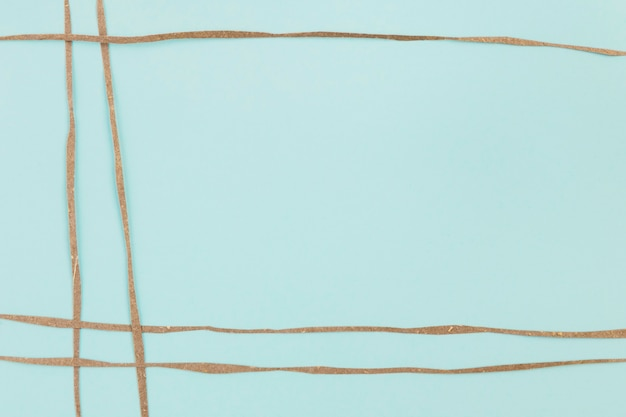 Blue background decorated with brown paper stripes