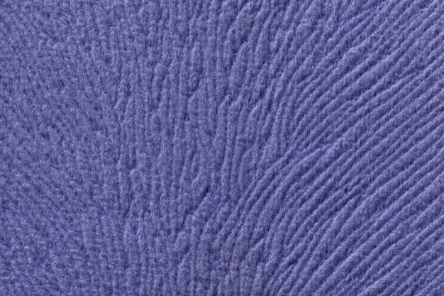 Blue background from soft textile material, fabric with natural texture,