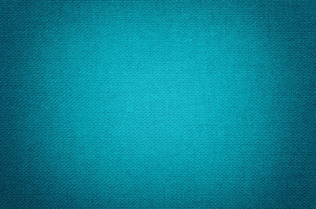 Blue background from a textile material with wicker pattern, closeup.