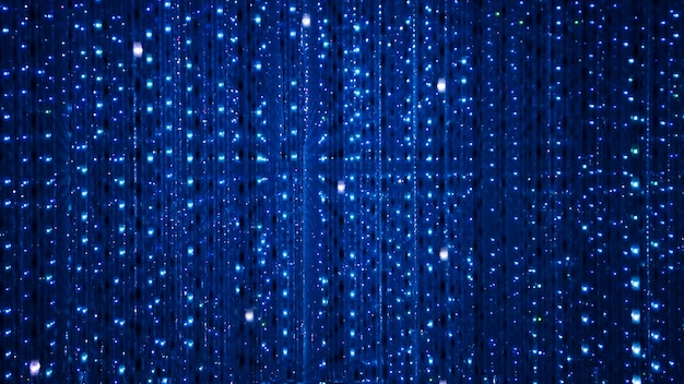 Blue background of led bulbs. disco and holiday illuminated neon shiny backdrop. abstract decoration from garland.