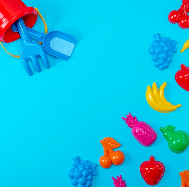 Blue background with childrens colorful toys