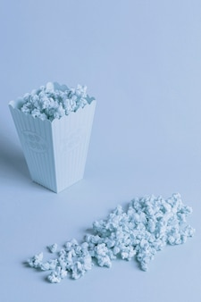 Blue background with isometric popcorn