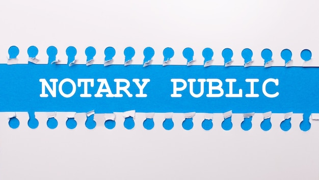 On a blue background with text notary public two white torn strips of paper.