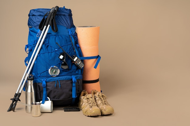 Blue backpack and hiking boots. mountain gear close up