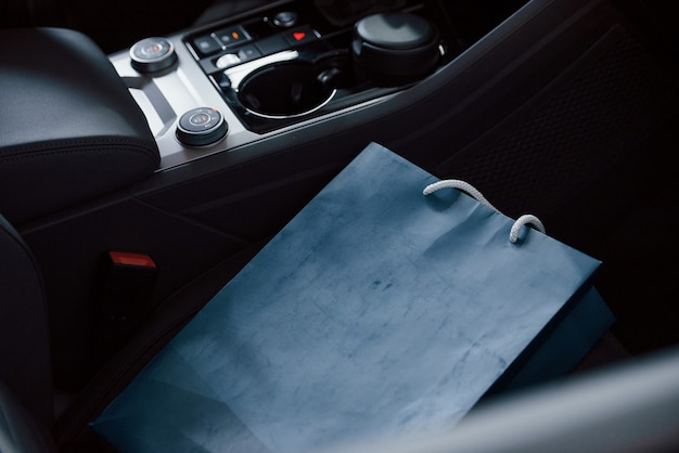 Blue bag lying in car. close up view of interior of brand new modern luxury automobile
