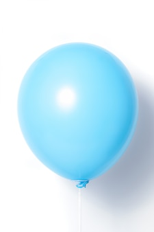 Blue balloon on white background with shadow. side glare.