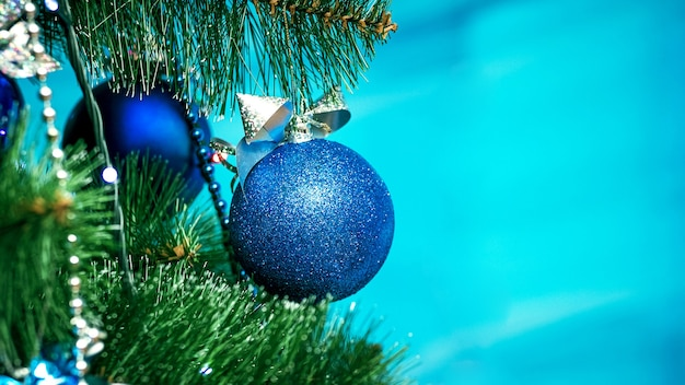 Blue balls decorate the christmas tree, copy space