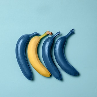 Blue bananas line with one clean banana