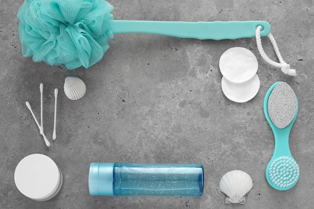 Blue bathroom accessories on concrete background. selfcare, body care, relaxation. top view, flat lay. free space for text, copy space.