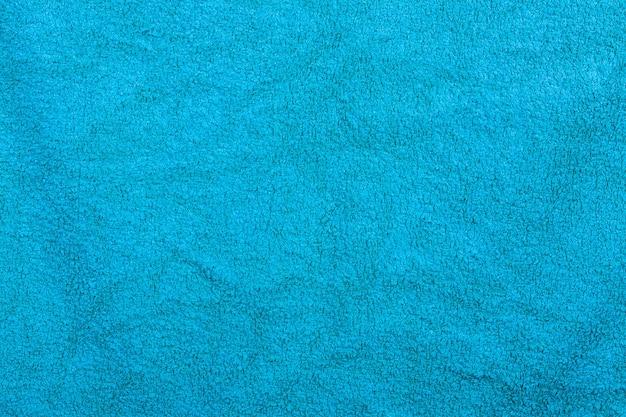 Синее полотенце для ванной текстильная фоновая текстура для дизайна и украшения экстремального крупным планом