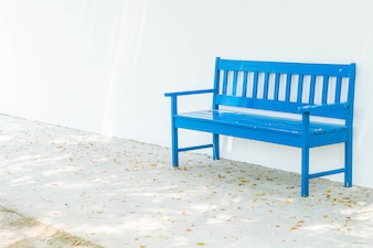 Blue bench with white wall