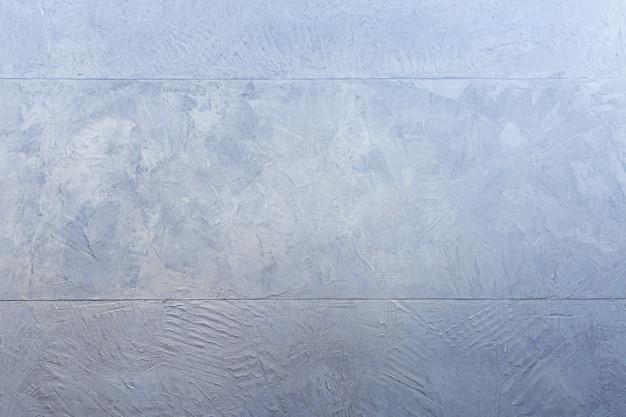 青いベトンコンクリートの壁、抽象的な背景写真のテクスチャ。