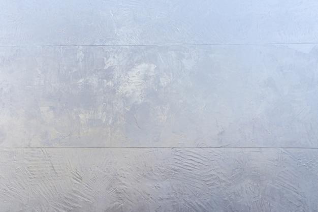 青いベトンコンクリートの壁、抽象的な写真のテクスチャ。