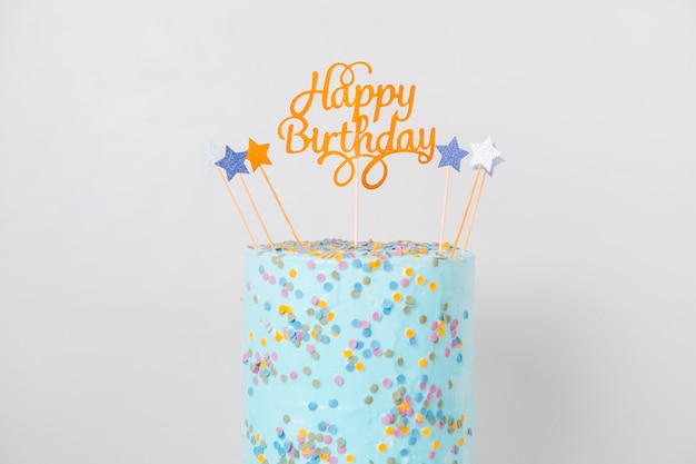 Blue birthday cake with topper