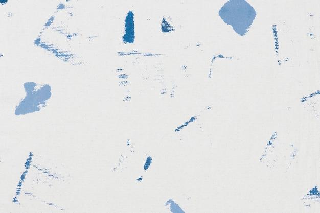 직물 얼룩이있는 파란색 블록 인쇄 배경 패턴